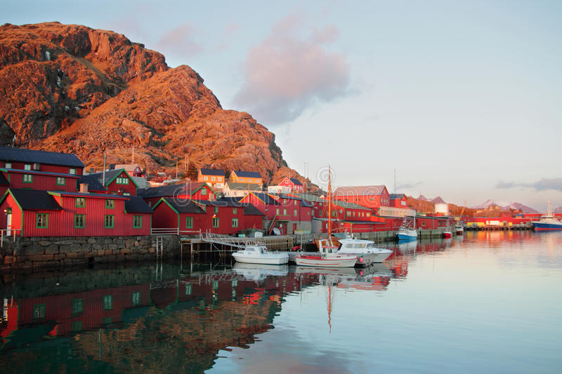 Stamsund downtown and boat. Old fisherman's cabins, called Burekka, in the harbour of Stamsund, Lofoten islands royalty free stock photo