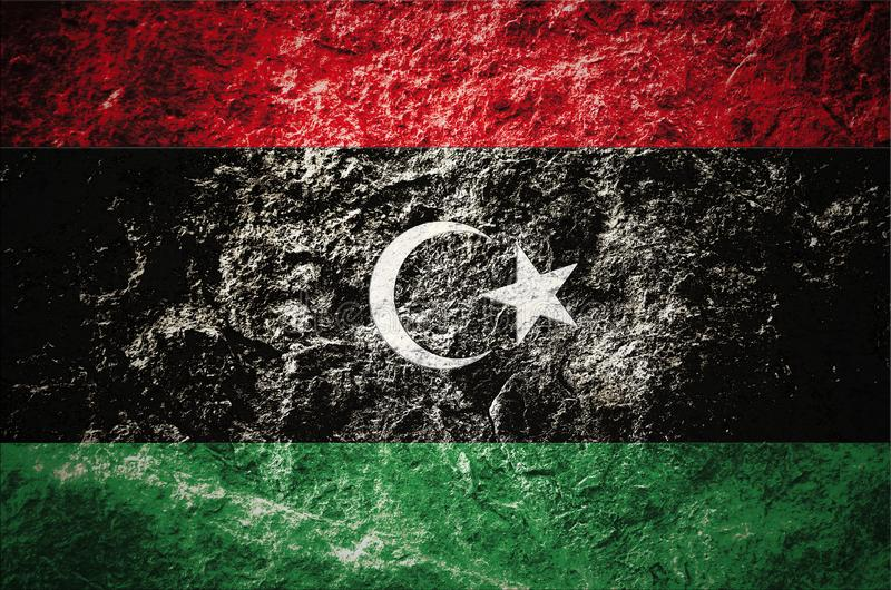 Stan Libia flaga na kamiennym tle royalty ilustracja
