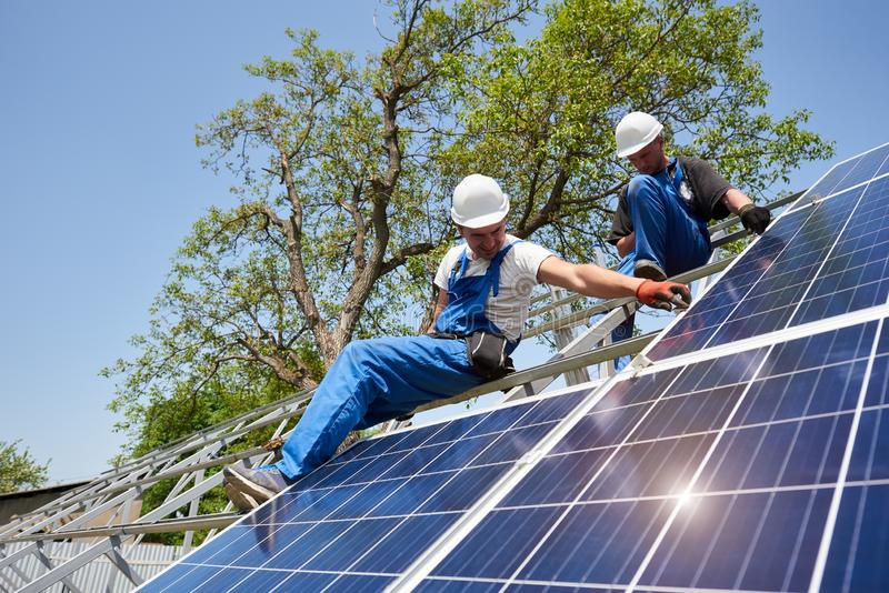 Stand-alone exterior solar panel system installation, renewable green energy generation concept. stock image