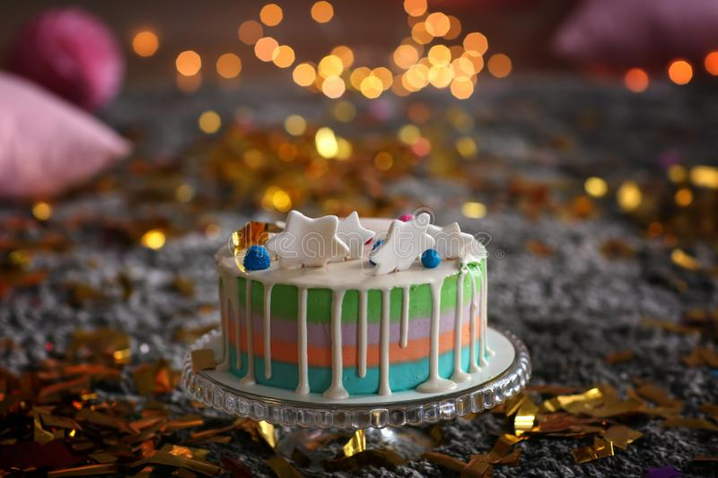 Stand with birthday cake on carpet royalty free stock photography