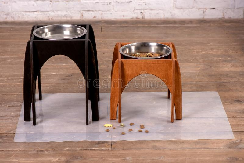 Stand for a bowl of dogs. dog food. bowl for dogs. Wooden stand. product with wood. stand with wood for a bowl of dogs. food in a bowl. dog food royalty free stock photos