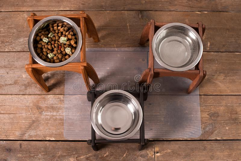 Stand for a bowl of dogs. dog food. bowl for dogs. Wooden stand. product with wood. stand with wood for a bowl of dogs. food in a bowl. dog food royalty free stock photo