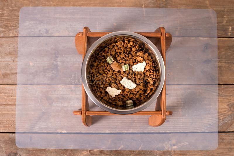 Stand for a bowl of dogs. dog food. bowl for dogs. Wooden stand. product with wood. stand with wood for a bowl of dogs. food in a bowl. dog food stock photos