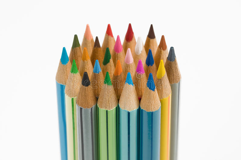 Stand colour pencils. Colored pencils stand on white background royalty free stock image
