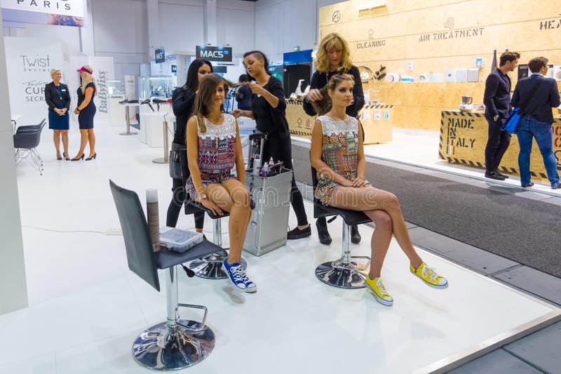 Stand of company BaByliss. BERLIN - SEPTEMBER 04, 2015: Stand of company BaByliss. Demonstration of stylists and makeup artists. International radio exhibition royalty free stock image
