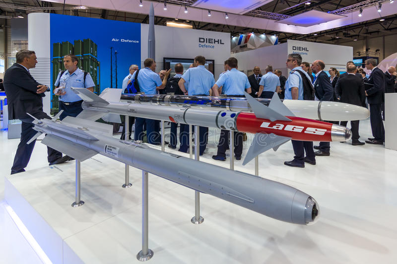 The stand of Diehl Defence. BERLIN, GERMANY - JUNE 01, 2016: The stand of Diehl Defence. Models of military missiles AIM-2000 IRIS-T and Laser-Guided Sidewinder stock image