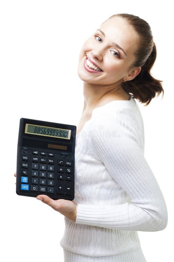 Stand heureux de femme avec la calculatrice photos libres de droits