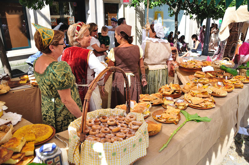 Stand of homemade food at fair. Pontevedra, Spain - 05 September 2009: Medieval Faires are themed fairs; arts, crafts, shows, and activities centered around the stock photos