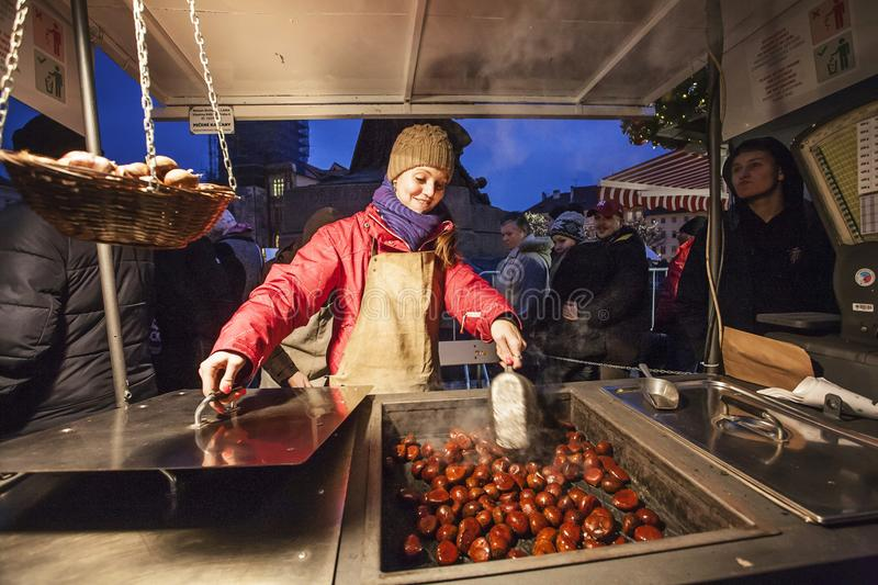 Stand with hot chestnut - winter specialty during christmas in Prague. Old town square, Czech republic, 2nd of December stock images