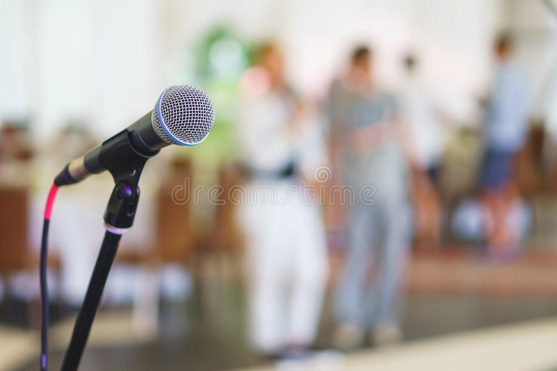 Stand with microphone on the stage prepared for the performance speaker. Stand with microphone on the stage prepared for presentation to the public speaker stock images