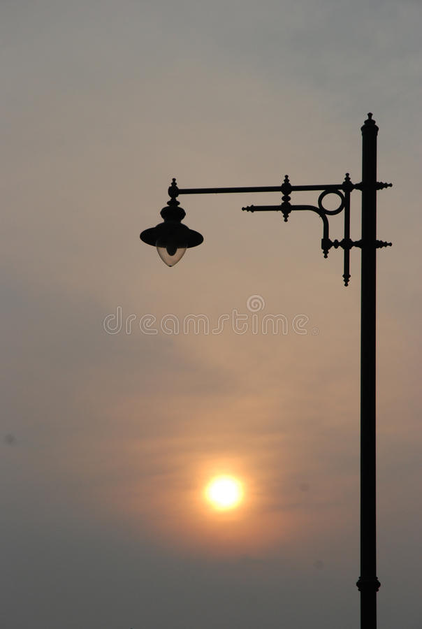 Stand of one lamp between sunset stock photography