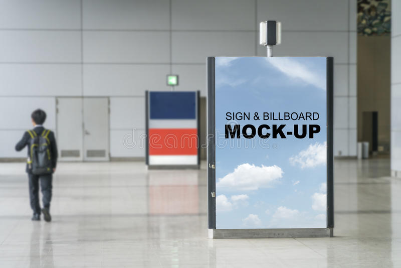 Stand sign or billboard Mock up Vertical indoor Advertising in a. A Blank with sky background sign billboard mock up the vertical indoor Advertising at stock photos
