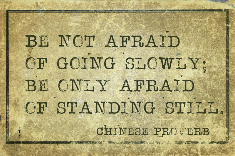 Stand still CP. Be not afraid of going slowly - ancient Chinese proverb printed on grunge vintage cardboard vector illustration