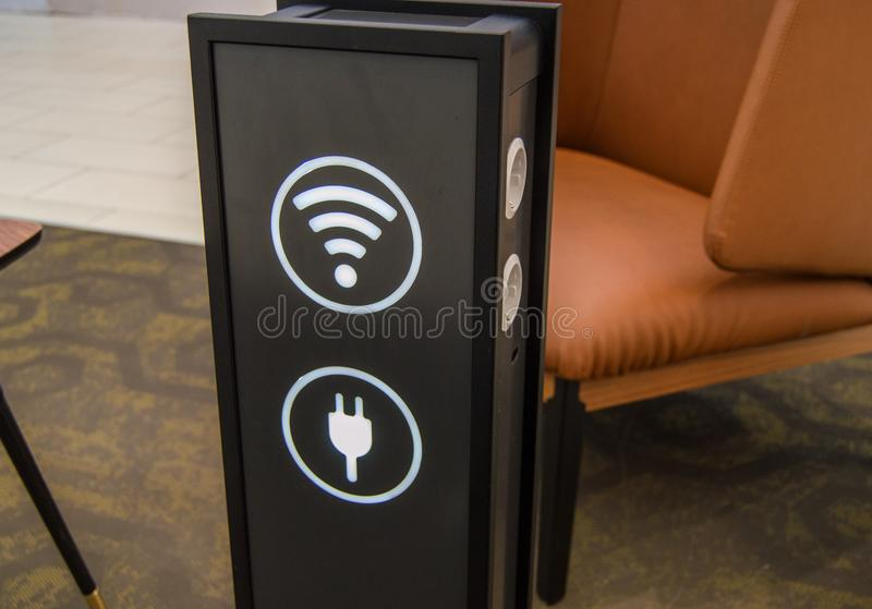 Stand tower for charging mobile phones in a shopping center, the sign of a wifi zone, background rest areas and service, the royalty free stock photography