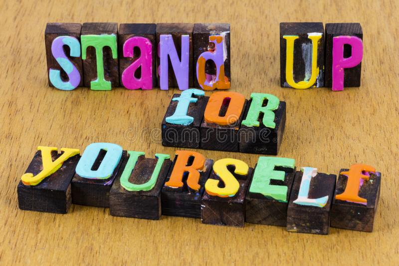 Stand up defend yourself confident honesty success believe. Typography painted text strong successful respect leader leadership business professional proud stock photo