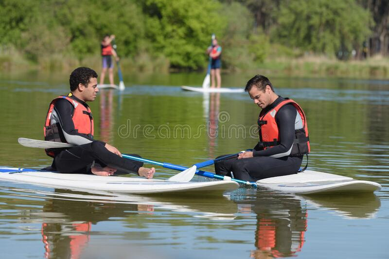 Stand up paddle board people royalty free stock images