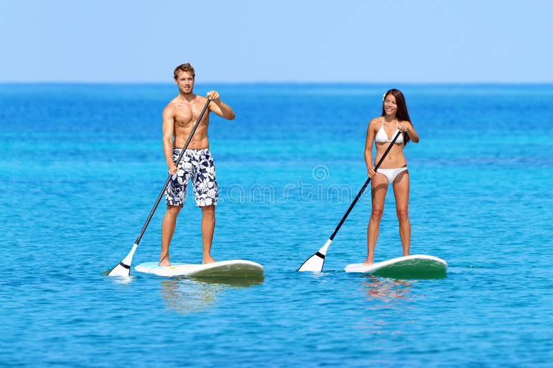 Stand Up Paddleboard Beach People On Paddle Board Stock Photo