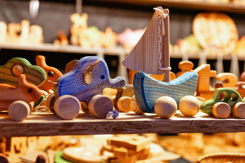 Stand with wooden toys decoration Christmas market, in winter Riga in Latvia stock image