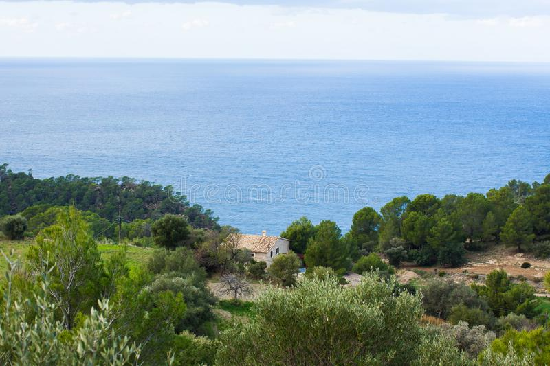 Standalone house with a seaview near Estellencs, Majorca stock photo