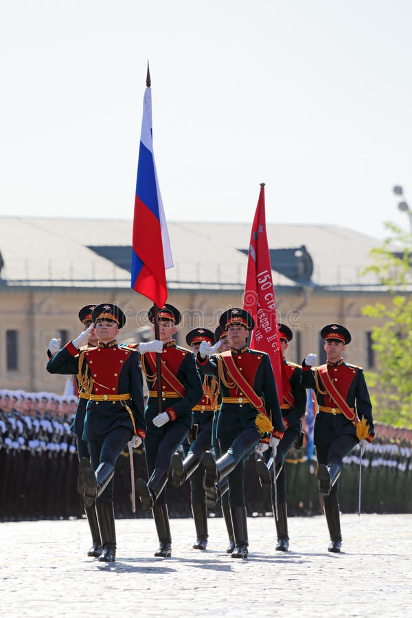 Standard-bearers. MOSCOW, RUSSIA - MAY 09, 2014: Celebration of the 69th anniversary of the Victory Day (WWII). Solemn passage of military hardware on Red Square royalty free stock photo