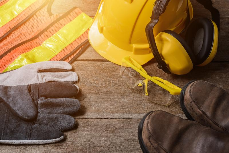 Standard construction safety equipment on wooden table. Standard construction safety equipment on old wooden background. safety first concepts stock image