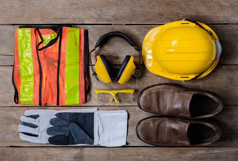 Standard construction safety equipment on wooden table. top view stock image