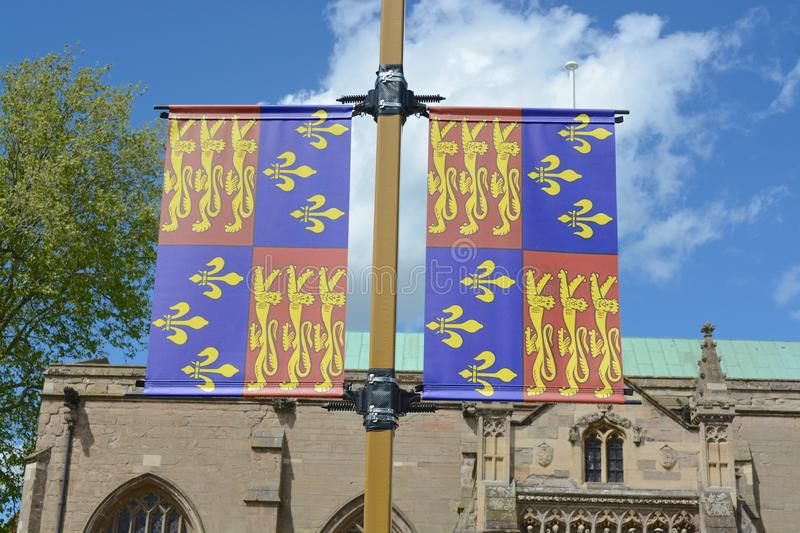 Standard of King Richard III. Standard, flag of king Richard III, with Leicester cathedral in the background stock images