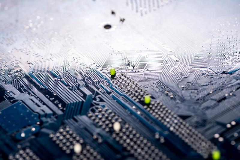 Standard motherboard with electrolytic capacitors and elements stock photography
