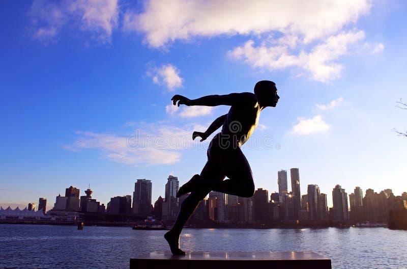 Standbeeld van Olympische agent in Stanley Park, Vancouver stock foto
