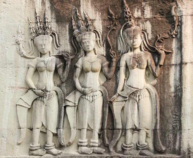 Standbeelden van dames op Angkor Wat Temple worden gesneden dat stock afbeeldingen