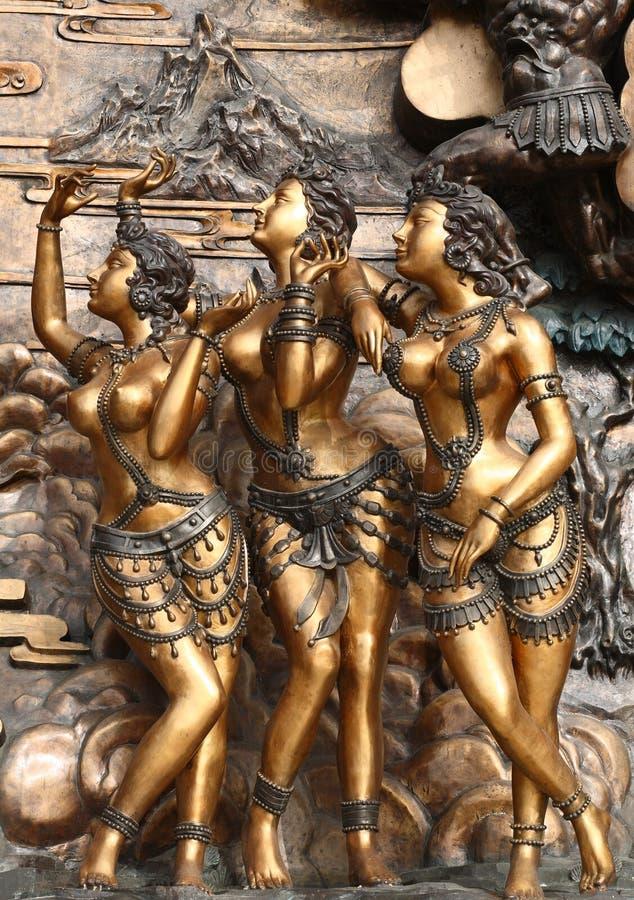 Standbeelden van drie vrouwen stock afbeeldingen