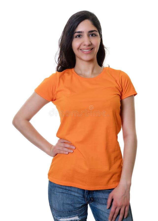 Standing arab woman with orange shirt royalty free stock photos