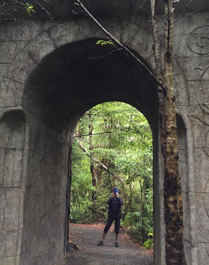 Standing at the arched entrance way to Rivendell. Standing at the arched entranceway in Kaitoke Regional Park. This area was used as a set for Rivendell in the stock photos