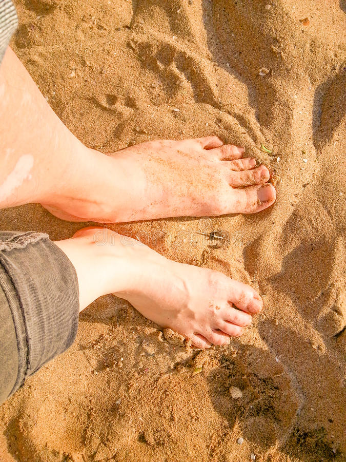 Standing barefoot on the beach top view. Sand texture. Standing barefoot on the beach stock photos