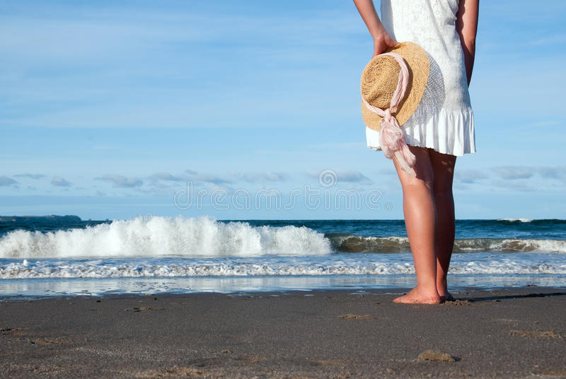 Standing at beach stock photography