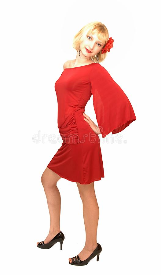 Standing blond woman in red dress 15. stock photography