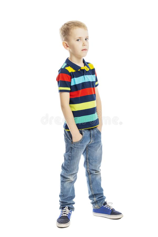 Standing boy in full growth in jeans and a bright T-shirt. Vertical. Isolated on a white background stock images