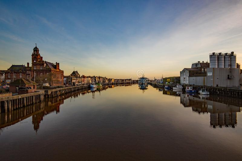 Looking down the Rier Yare towards the sea with historic South Quay on one side and industrial units on the other. Standing on the bridge looking down the River stock image