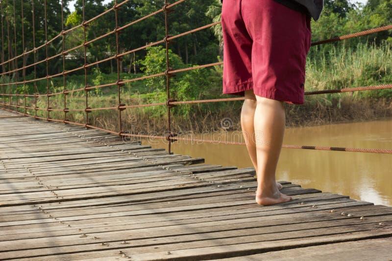 Standing on the bridge stock photography