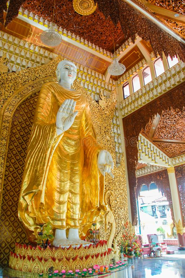 Standing Buddha statue in Dhammikarama Burmese temple in Penang royalty free stock images