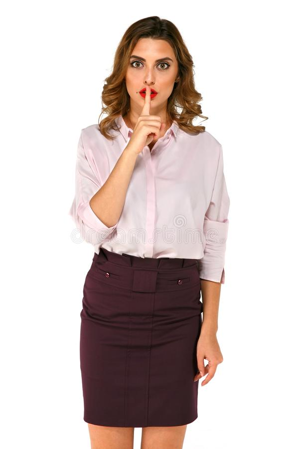 Standing business woman shows gesture silence stock images