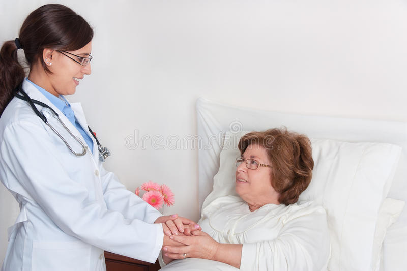 Download Standing Doctor Comforts Senior Patient Stock Image - Image of reassuring, illness: 23813073