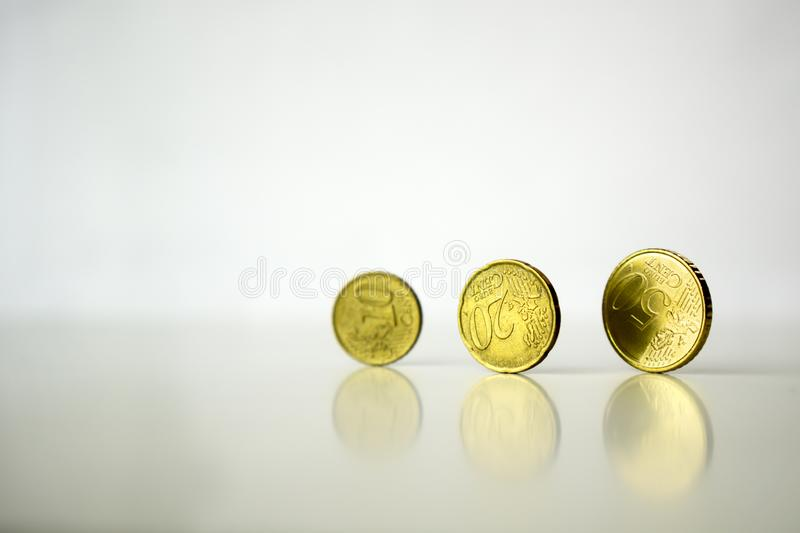 Standing euro coins cents on gray background royalty free stock image