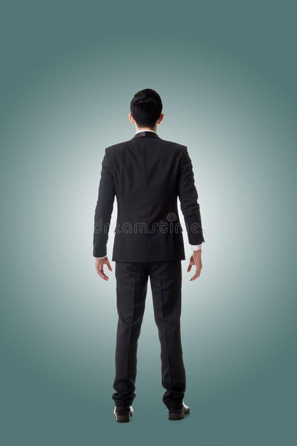 Download Standing för affärsman fotografering för bildbyråer. Bild av meditera - 76700999