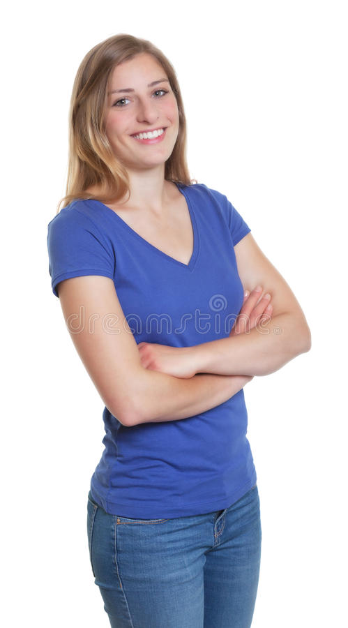 Standing german woman in a blue shirt with crossed arms. On an isolated white background for cut out stock photos