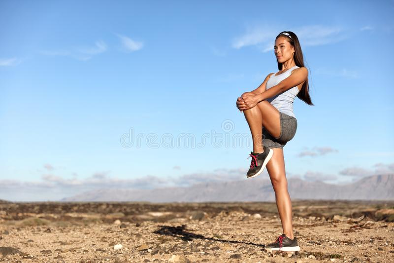 Standing Glutes leg stretch fitness woman workout. Standing Gluteus maximus leg stretches. Fitness woman doing stretch exercises workout stretching glutes stock photo