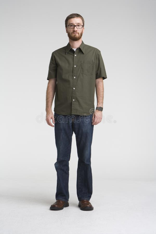 Standing with green shirt stock photo