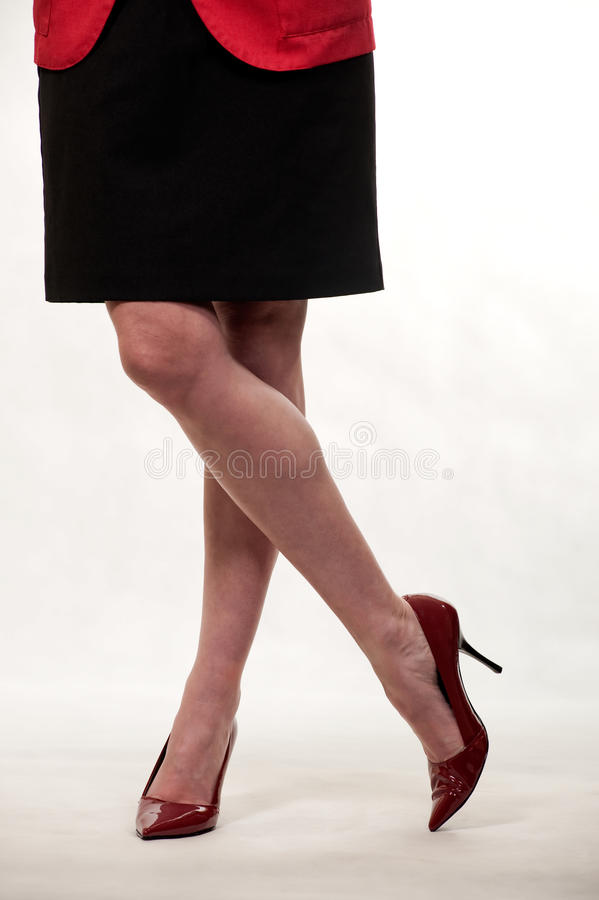 Download Standing with legs crossed stock image. Image of fashion - 15596097