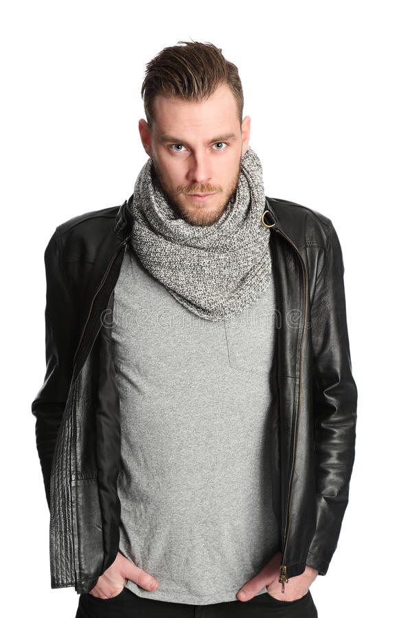 Standing man with scarf and leather jacket stock photography