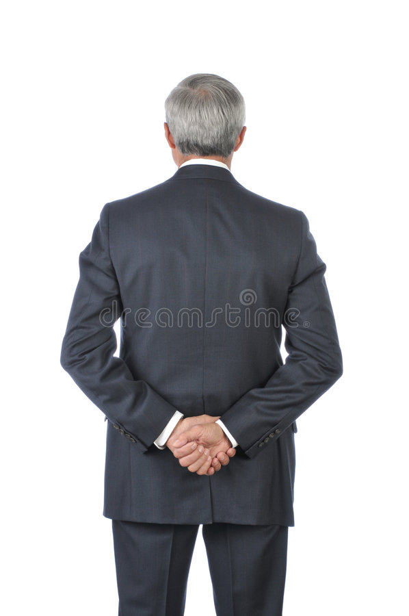 Standing Middle Aged Businessman hands Behind Back royalty free stock photography